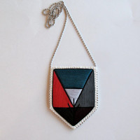 Embroidered pendant necklace with colorblock geometric design in dark teal red black gray plum with silver ball chain