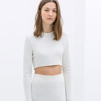 ASYMMETRIC CROP TOP