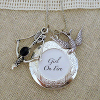 Hunger Games Silver Girl On Fire Locket Necklace by jessicajanek