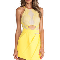 Three Floor Sicily Playsuite in Nude & Sunshine Yellow from REVOLVEclothing.com
