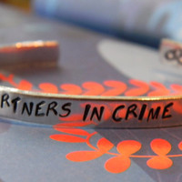 Partners in crime handcuffs inside aluminum bracelet