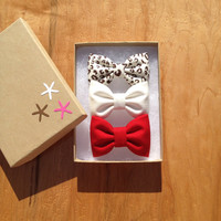 Cheetah, red, and winter white hair bows from Seaside Sparrow. Perfect gift for her.