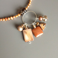 Caramel Brown Necklace with a Circular Pendant and a Cascade of Brown Treasures