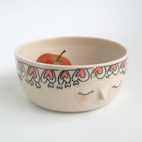 Hand carved serving bowl with a sweet litle friendly face and a hearts bush head band/frill
