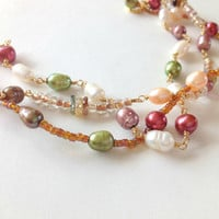 Panetone Colors Spring 2014 Hemlock and Purple Haze Pearl and Tourmaline gold bracelet.