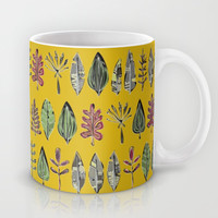leaves and feathers saffron Mug by Sharon Turner