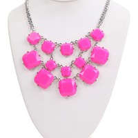 short statement necklace with neon square stones