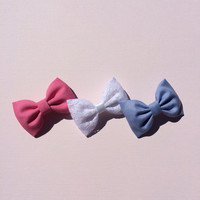Bright pink, light blue shirting and white lace hair bows from seaside sparrow.