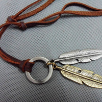 Leather necklace and alloy feather pendant by jewelrybraceletcuff