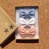 Blue chambray, white linen, and peach hair bows from seaside sparrow.