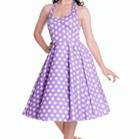Stay fresh and girly with the Spring Potion Mariam 50's Pinup Dress by Hell Bunny. This sleeveless dress features large scale white polka dot print throughout against with lavender background, sweetheart neckline with seams over bust for shaping, adjustabl