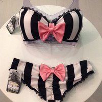 Black and white stripe swimsuit bow bikini top and bow bikini bottoms.