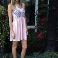 Pink babydoll dress with embellishments