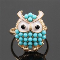 Gold adjustable owl ring with blue beads