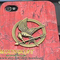 The Hunger Games Logo Brass Mockingjay Pendant Red by moonboat
