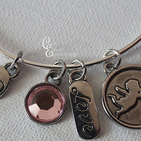 "Silver Love themed Bangle Bracelet with pink gem, cupid, heart and ""Love"" charms"