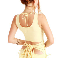 Pale sun yellow women top with an open back and a by Shovava