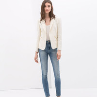 STRUCTURED BLAZER WITH ZIPS