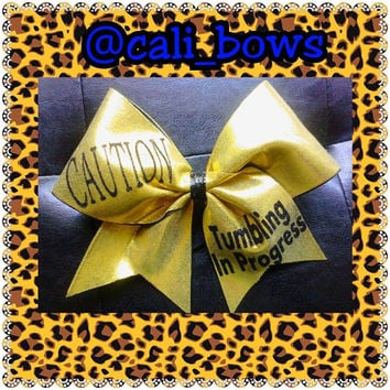 Caution Tumbling in Progress cheerbow as seen on Instagram
