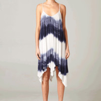 Go the extra mile in the Summer Trance Tie Dye Dress. This slip on style sleeveless maxi dress features plunging scoop-neckling, adjustable spaghetti straps, grey tie dye color against white background accent throughout, sexy low scoop back, and finish wit