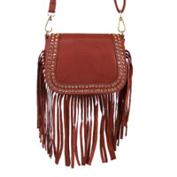 "Sneak through the season with this Forever Fringe Crossbody Bag. Featuring gold tone studded at front flap, chic crossbody style with fringe construction, full interior lining, zipper pockets, and finished with an adjustable shoulder strap with an 23"" drop"