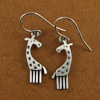 Giraffe earrings by StickManJewelry on Etsy