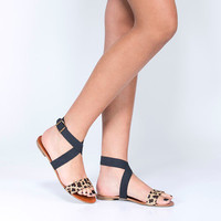 Leopard and black shoes. open flat sandal.
