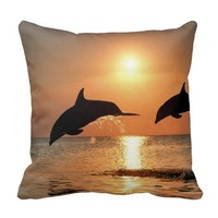 Dolphins by Sunset