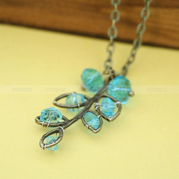 Antique brass necklace with aqua blue crystal pendant by mosnos