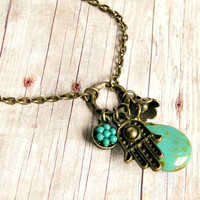 hamsa brass and aqua glass charm necklace, antique brass, yoga, hand of fatima
