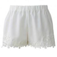 White shorts with crochet hem