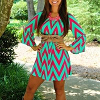Hillary chevron printed dress in fuchsia and mint. Polyester and spandex blend.