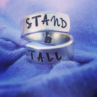 Stand tall/ giraffe   inside spiral ring