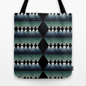 A Break in the Storm Tote Bag by Halfmoon Industries