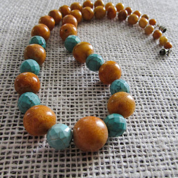 Graduated Vintage wood and faceted turquoise color howlite beaded statement necklace.