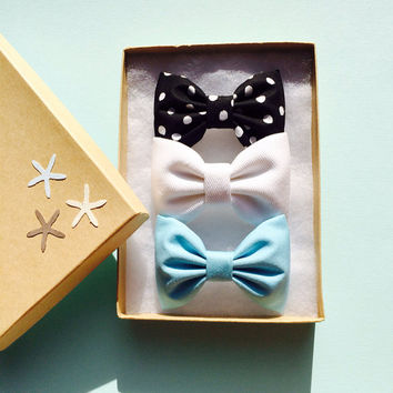 Black and white polka dot, white denim, and tiffany hair bows from Seaside Sparrow.  Perfect gift for her.