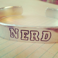 Nerd , geek, awkward, weird, bracelet 3/8 wide in aluminum or copper 6 inches long