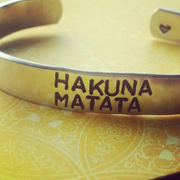 Hakuna Matata bracelet made from aluminum / 3/8 inch wide heart  stamped on the inside it means no worries