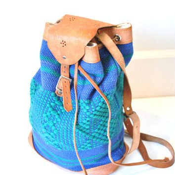 woven ikat and leather bucket bag