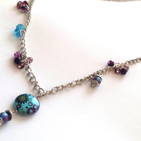 Long pewter chain necklace with purple and turquoise bead clusters