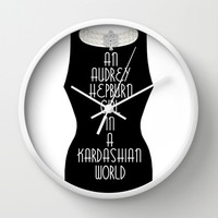 An Audrey Hepburn girl in a Kardashian world Wall Clock by Miss Golightly