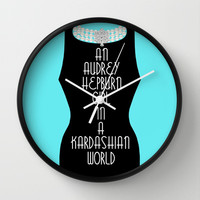 An Audrey Hepburn girl in a Kardashian world (in blue) Wall Clock by Miss Golightly