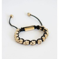 Black Bracelet with Gold Skulls