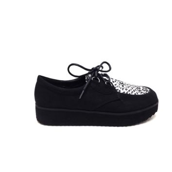 Featuring faux suede upper contrast with black leopard print on white color leatherette, round toe, lace up front, chunky stacked platform, stitching details, and finished with cushioned insole for comfort.