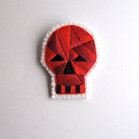 Halloween skull brooch with red geometric design hand embroidered on cream muslin and cream felt Day of the Dead