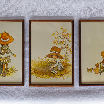 Holly Hobbie Retro 3 piece Nursery Art Wall Art Framed Print Set Brown Orange Khaki Green Cream coloured in dark oak wooden frames