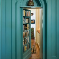 Exterior: Gorgeous Secret Passage Bookshelves Behind The Door With Blue Light Color Scheme And Geometric Shaped Door Along With Vertical Shaped Bookcase. Vertical Bookcase, Bookcase Antique, Bookshleves Scheme, Bookshelves Shape, Passage Bookcase | Inspira