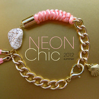 Beautifully knotted silk cord neon pink bracelet on gold chain with howlite stones and a fringe detail.  Pink neon jewelry.