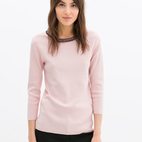 Sweater with diamante collar