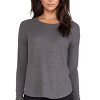 alo Extreme Curved Long Sleeve Top in Charcoal
